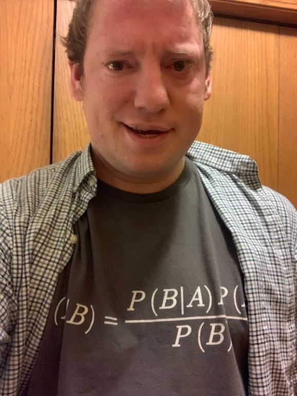 Me wearing a shirt with Bayes' theorem last year.