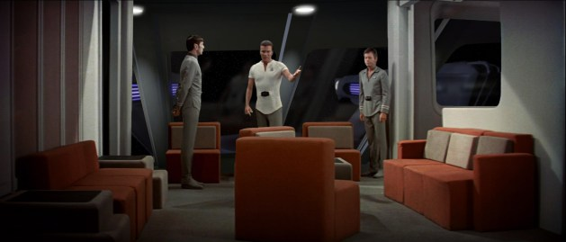 Spock, Kirk and McCoy catch up in the fancy new officer's lounge aboard the USS Enterprise.