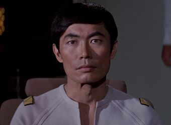 George Takei tries to figure out what Lt. Sulu is looking at on the bridge.