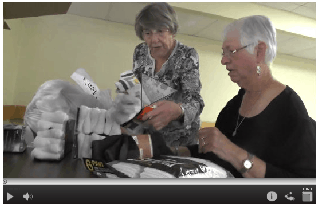 Grey Nun Academy sorts new socks for the homeless for The Joy of Sox - a nonprofit that provides joy to the homeless with new socks.