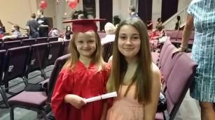 Portrait- My two daughters- Pre-K graduation.