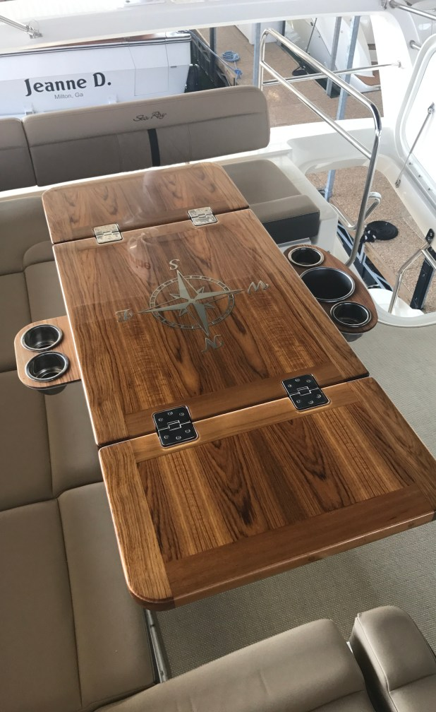 Completed teak table extended laser cut stainless cup holders 3 leaves folded out including wine chiller trays.