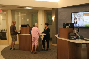tlcd architecture, exchange bank windsor, bank branch of the future, cash bar for transactions