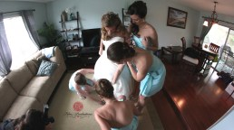 girls helping aley with her dress