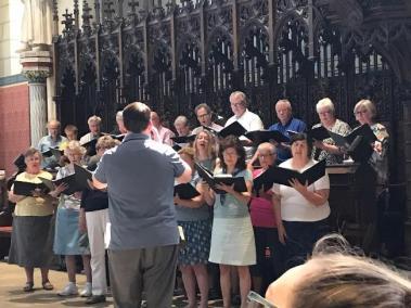 The Grace Lutheran choir singing from choir.