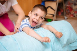 child with cerebral palsy during physical therapy