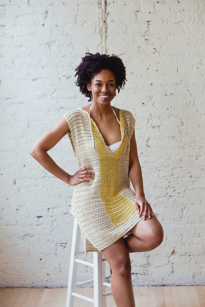 Try the Lemonade Top, a fun swimsuit coverup crochet pattern from TL Yarn Crafts. Push your crochet skills to the next level by trying lace. Small details like hip slits and a bowtie collar bring this entire project together.