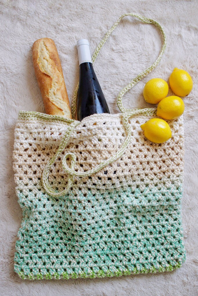 Make the Fresh Market Tote, a fun and FREE crochet market bag pattern from TL Yarn Crafts. Combine cotton and acrylic yarn for a sturdy and beautiful bag. Includes full FREE pattern and video tutorial. Perfect for Mother's Day, teacher gifts, and housewarming gifts.