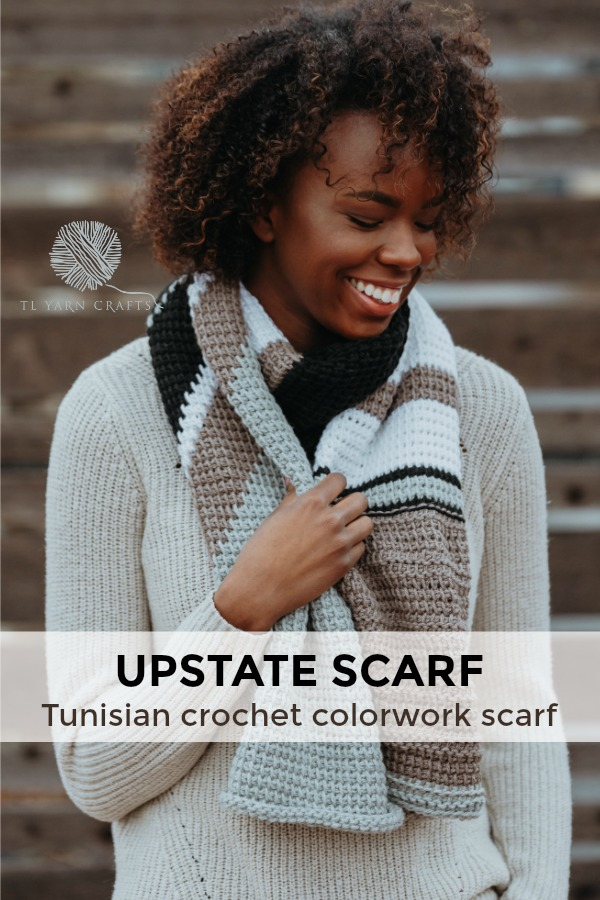 Make the new Upstate Scarf from TL Yarn Crats, a Tunisian crochet pattern that includes colorwork, bold stripes, and textured stitches. Pattern includes a helpful chart and links to Tunisian crochet instructional videos. Sample made with Spud & Chloe Yarn; project sponsored by LoveCrochet and Blue Sky Fibers. | TLYCBlog