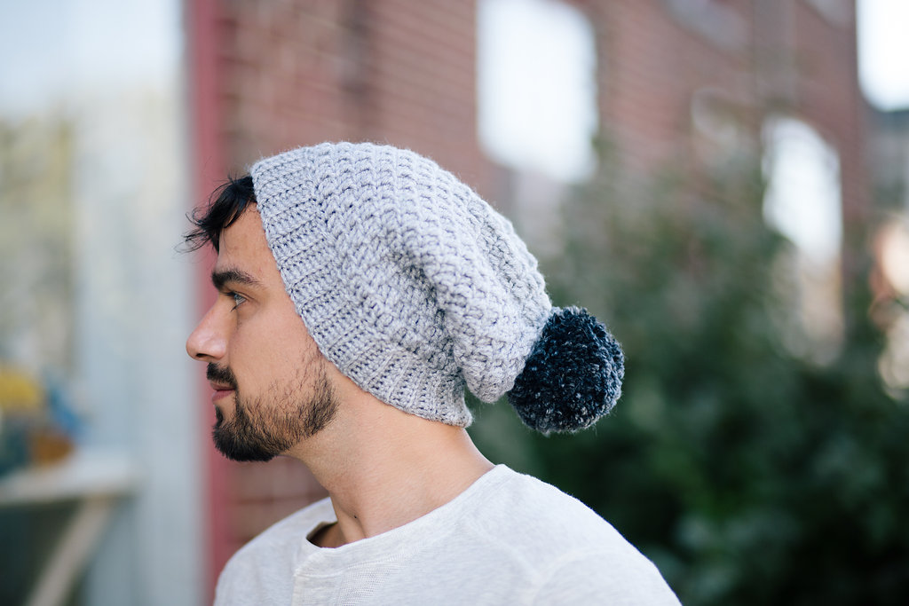 If you're looking for your new go-to crochet slouchy hat pattern, the Mega Pom Beanie is for you! This unisex crochet pattern is unisex and makes a great women's beanie or men's beanie. And the best part is that you can make this textured, gorgeous hat in no time - about 90 minutes! Try it with luxury yarns like those available from Baad Mom Yarns. Visit my blog for more details and to start making your own Mega Pom Beanie! | TLYCBlog.com