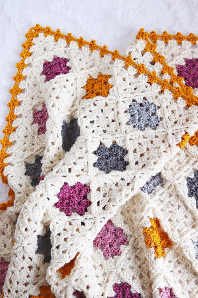 Sweet Granny Baby Blanket | Express your love to classic crochet style by making the Sweet Granny Baby Blanket. I've put a modern twist on the traditional granny sqaure and given it a modern color palette. Free crochet pattern includes a helpful chart and row-by-ros instructions.| TLYCBlog.com #crochet #granny square #freecrochetpattern #crochetbabyblanket