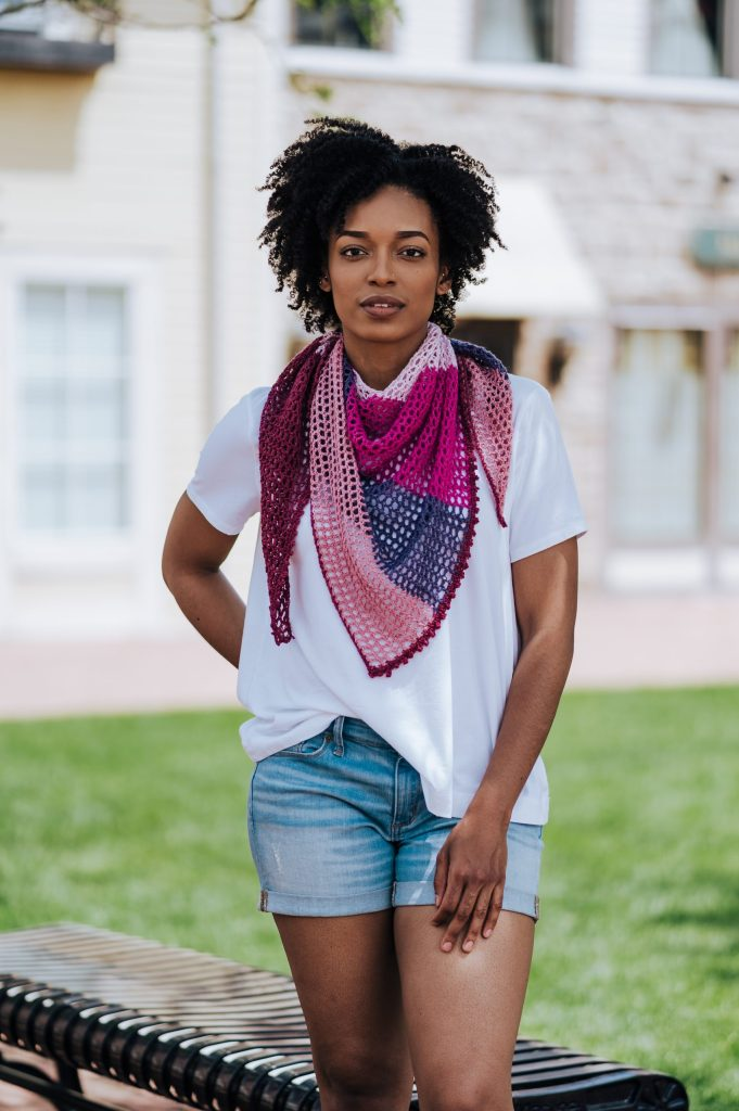 Feel the summer breeze with the easy & fun Carillon Shawl, a FREE pattern with tutorial video, now availalbe on TLYCBlog.com. This lovely crochet wrap is starts with just a few stitches and grows with each row. The result is a colorful crochet shawl that's perfect in any season.| TLYCBlog.com #crochet #shawl #freecrochetpattern #summer #beginner