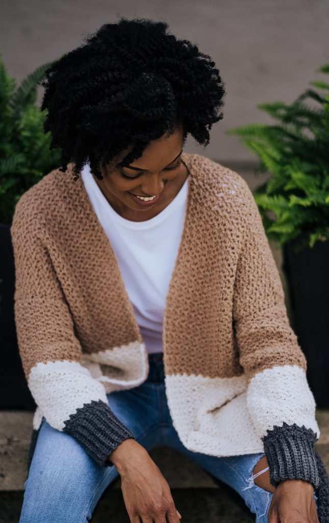 Are you new to crochet garments? Try the Dina Cardi, a beginner level crochet color block sweater with pockets. Customize your colors by building your own project kit with Mary Maxim's Ultra Mellowspun yarn and get the pattern from TLYarnCrafts.com | TLYCBlog.com