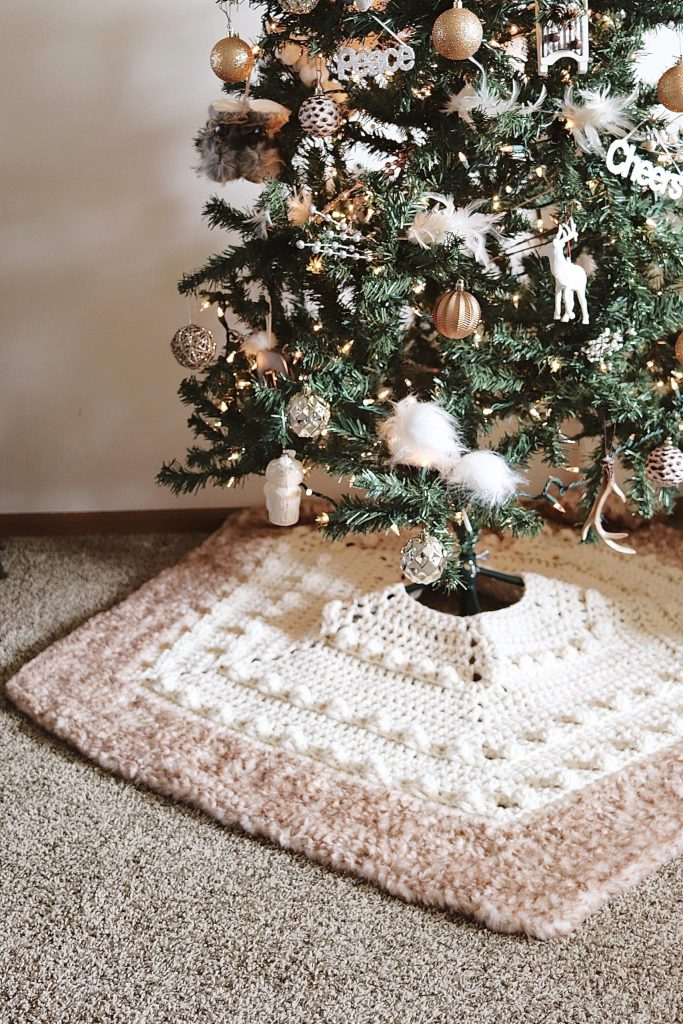 Free Crochet Tree Skirt Pattern | Solstice Tree Skirt - Make this fun and festive crochet tree skirt using this FREE pattern from TLYCBlog.com. Use super bulky chunky wool yarn with faux fur for a glam look. This easy pattern works up in just a few rows using the easy to read row by row instructions. Make your Christmas tree shine with the Solstice Tree Skirt, a free crochet pattern. | TLYCBlog.com
