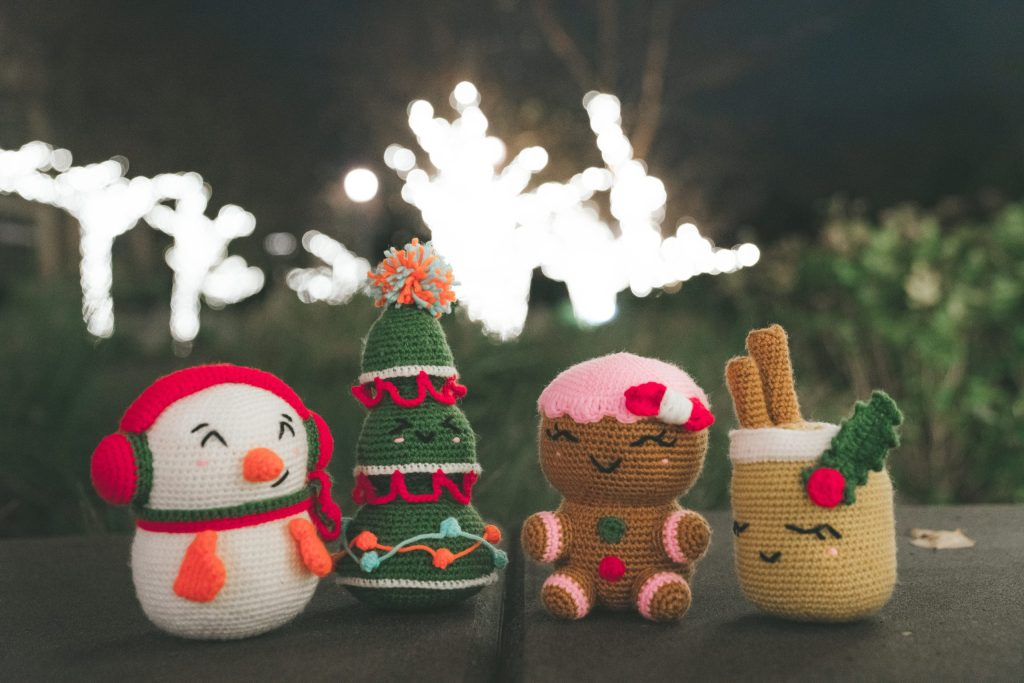 25 Crochet Christmas Patterns |  FREE and paid crochet Christmas patterns. DIY holiday decor and gifts this year. Make a crochet Santa, amigurumi, tree skirt, napkin rings, faux fur cowl, Christmas stocking, gingerbread doll, cozy mittens, pom pom scarf, corner to corner blanket, c2c afghan, start ornament, elf hat, faux fur vest, owl ornament, blanket scarf wrap, faux fur slippers, cowl neck poncho, pom pom hat. | TLYCBlog.com