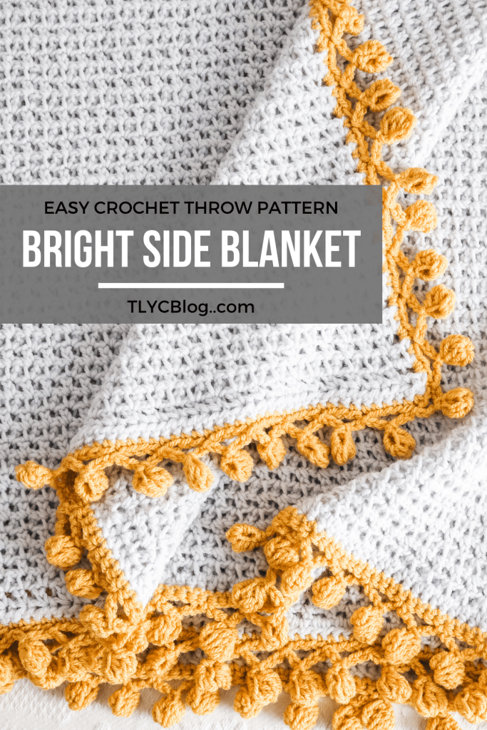 Minimalist meets modern when you crochet the Bright Side Blanket. This pattern is perfect for beginners - the body uses a meditative mesh stitch while the boded consist of playful bobbles. Make one for any room that needs a pop of color. | TLYCBlog.com #learntocrochet #beginnercrochet #crochetstitch #freecrochetpattern #crochetblanket