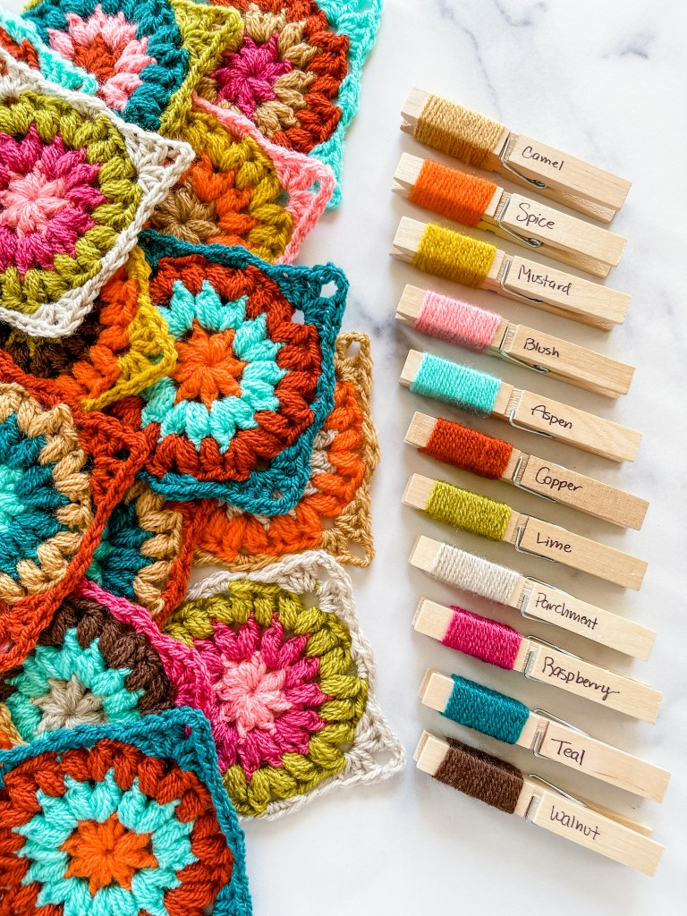 Crochet an autumn-inspired afghan. Design and make your crochet blanket from scratch.Granny square multicolored afghan free pattern.