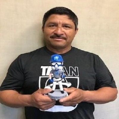 Laurentino Landaverde Won TMI Man Of The Year For Tanks, He Smiles Holding His Trophy.