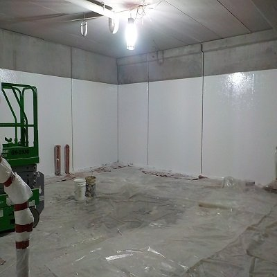 TMI Coatings FIBERLIFE application to food processing walls by TMI workers