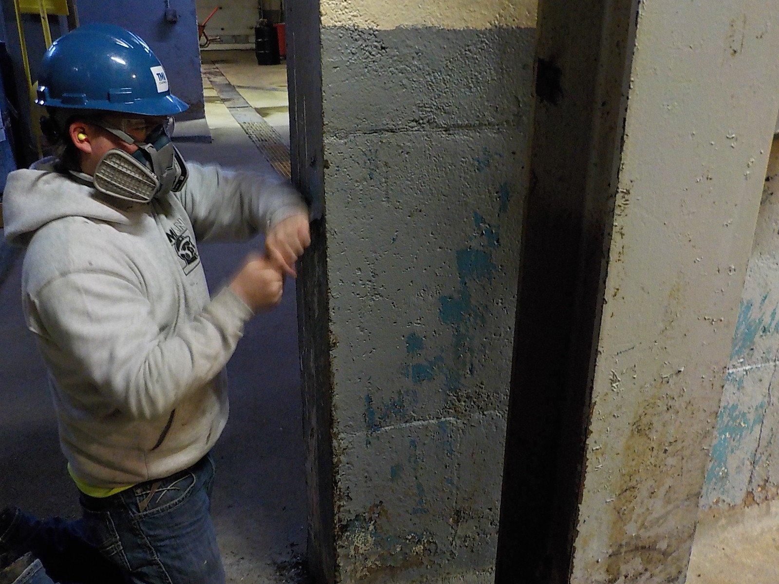 TMI MAN hard at work preparing the walls for FIBERLIFE coating