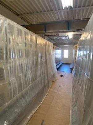 Extensive poly covering employed by TMI Coatings