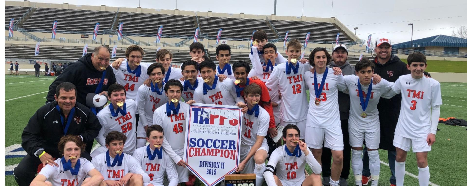 Photo of The TMI boys varsity soccer team celebrating their state championship on Feb. 22 in Waco.