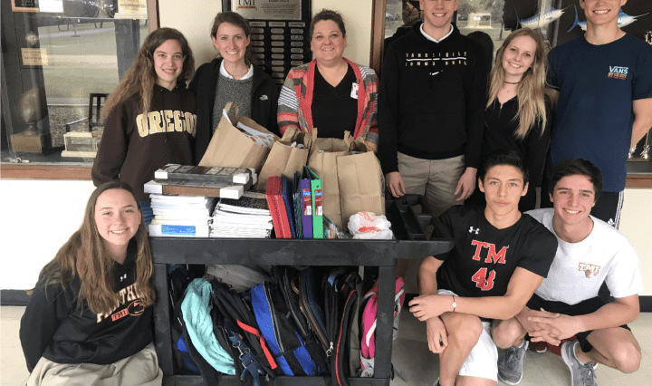 Picture of TMI students getting ready to present the school supplies they collected for children at San Antonio's Battered Women's and Children's Shelter.