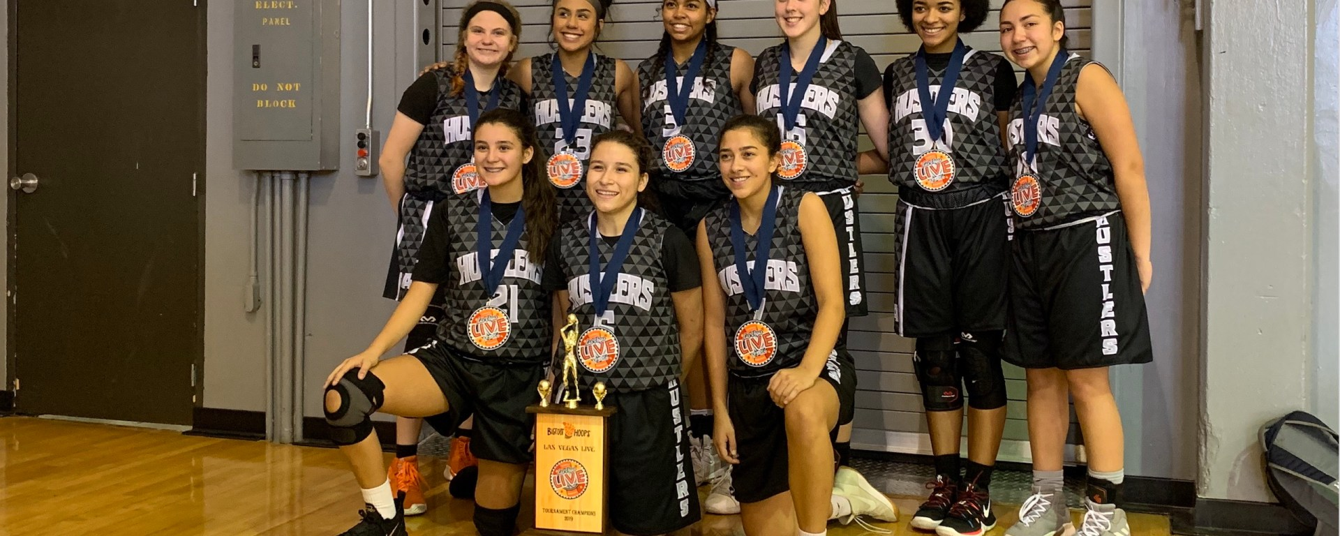 Photo of rising junior and her basketball team winning their division championship