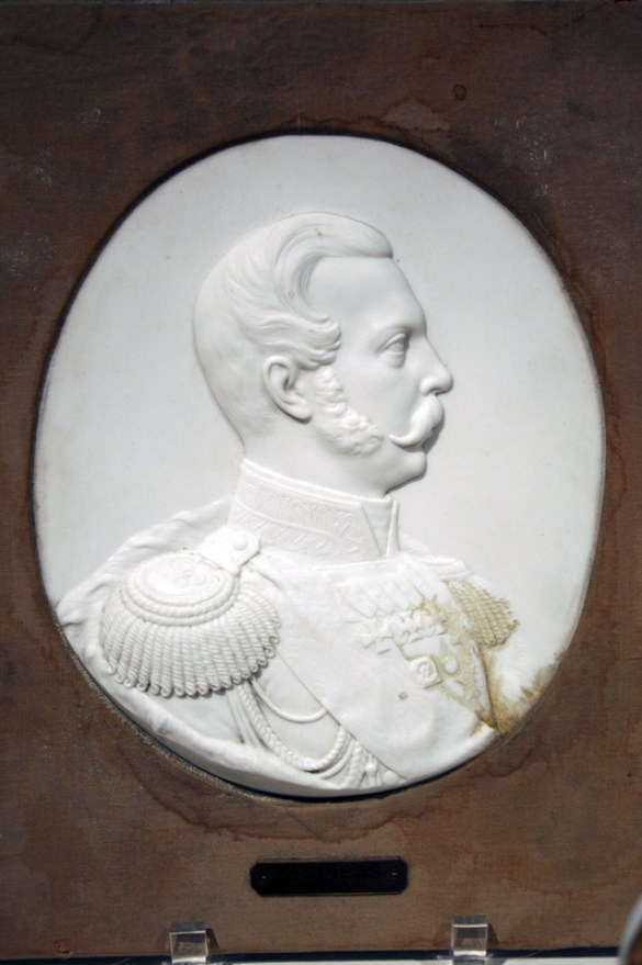 """Bisque Bas-relief Portrait of Alexander II, Winter Palace, Neoclassical Style, 1860. Hard paste porcelain. 13"""" x 11 1/4"""" (Frame), 9 1/4"""" (Plaque). Raymond F. Piper Collection."""