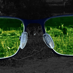 A pair of glasses with a green image of kangaroos showing despite the dark