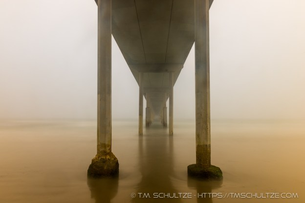 Fog Under The Ocean Beach Pier