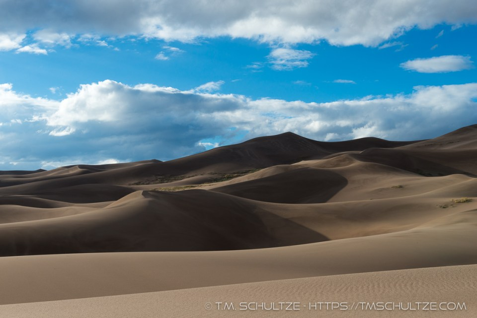 Sand Dunes To Clouds by T.M. Schultze