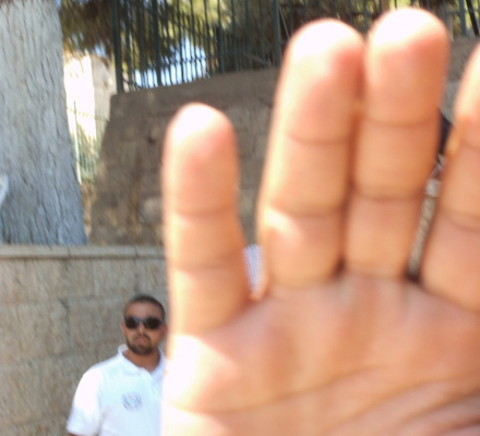 Violence on the Temple Mount - hand held up to stop