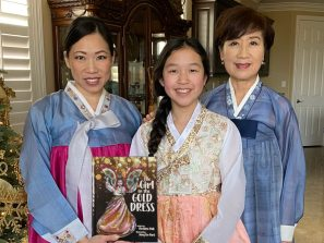 """Christine Paik, her daughter, and her mother, Jung Lin Park. Three generations with The Girl in the Gold Dress: a children's book that is """"an engaging, accessible narrative of immigration, resilience, and connections between generations.""""-Kirkus Review"""