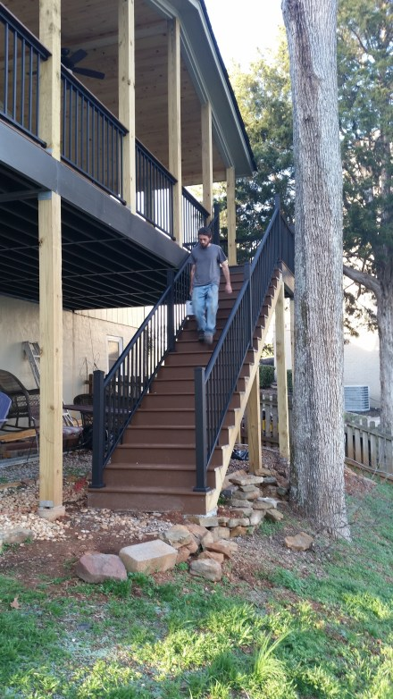 finished trex steps with aluminum hand rails