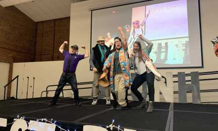 Best Buddies strut down runway in fashion show