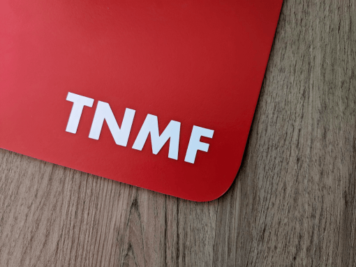 T N M F sticker on a red mudflap