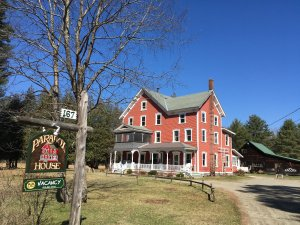 A picture of a big red farm house which is the Paradox House Retreat B&B