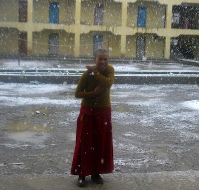 Buddhist nun in snow at Sherab Choeling Nunnery Spiti