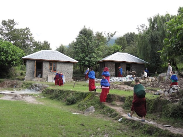 Tibetan Buddhist nuns building the retreat huts at Dolma Ling Nunnery