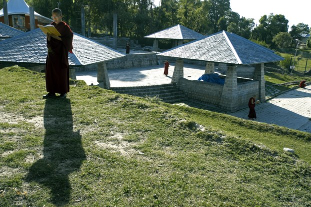 Buddhist nun studying at Dolma Ling Nunnery by Brian Harris