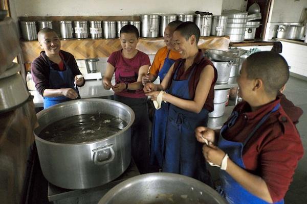 Tibetan Buddhist nuns in kitchen at Dolma Ling Nunnery. Tibetan Nuns Project