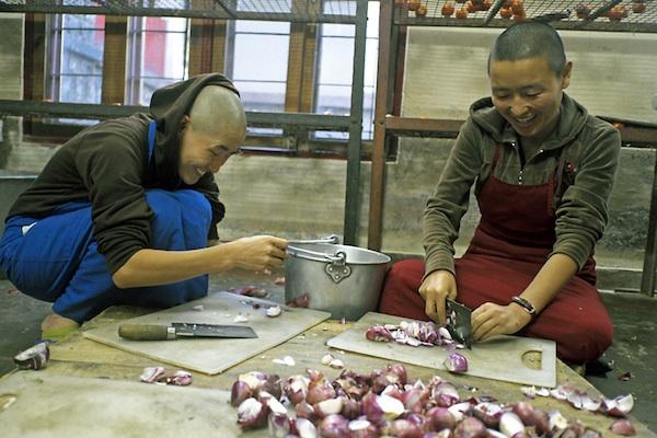 Tibetan Buddhist nuns chopping onions at Dolma Ling Nunnery - Brian Harris copy