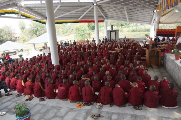Tibetan Buddhist nuns in debate courtyard with new roof