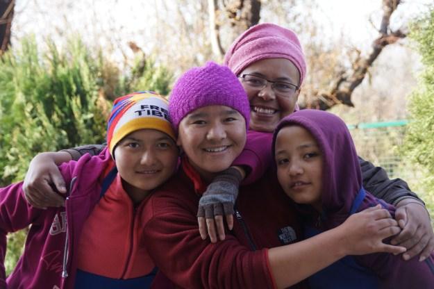 4 Tibetan Buddhist nuns smiling