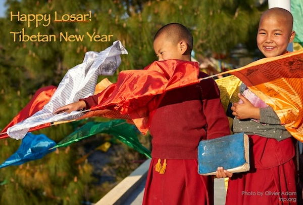 Happy Losar card - nuns hanging prayer flags by Olivier Adam