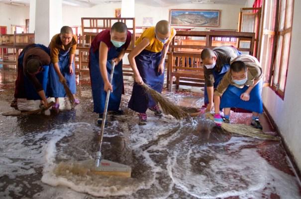 Tibetan Buddhist nuns washing the floor in the nunnery