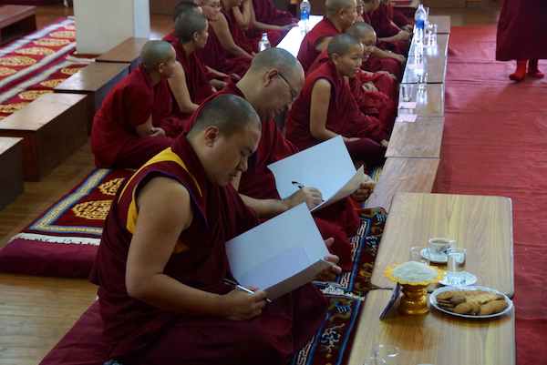 Tibetan Buddhist nuns and their teachers during oral examination Geshema exams 2014