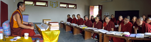 Monk teaching Tibetan Buddhist nuns by Brian Harris