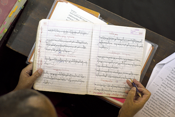 detailed photo of Tibetan writing in A Tibetan nun's notebook at Dolma Ling Nunnery and Institute